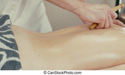 Woman recieve reflexology massage - Masseur doing massage on...