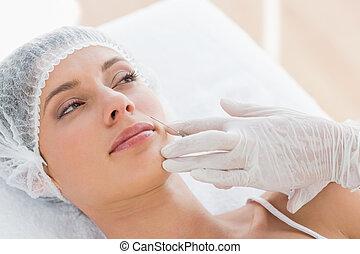 Woman recieving botox injection