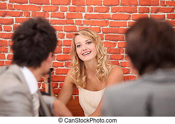 Woman recognizing colleagues in restaurant