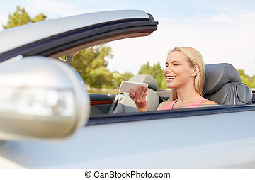 woman recording voice on smartphone at car