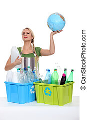 Woman recycling and holding planet earth in her hands