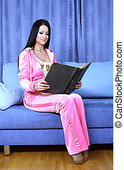 woman red book at home in sofa