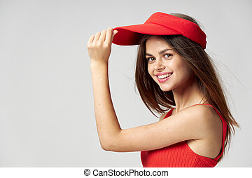 Woman red cap on head attractive look smile lifestyle