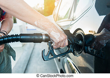 Woman refueling car at the gas station