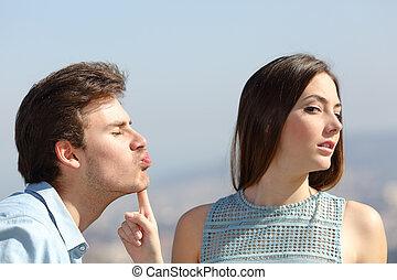 Woman rejecting a friend kiss