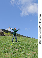 Woman rejoicing in the sunshine