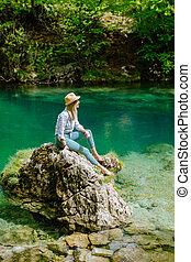 woman relax at mountain lake view