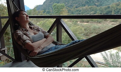 Woman relax in a hammock