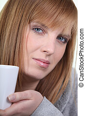 Woman relaxed drinking tea