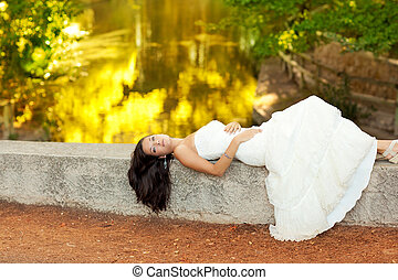 Woman relaxed in autumn golden forest river