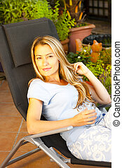 Woman relaxes on the terrace