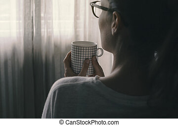 Woman relaxing and having a coffee break