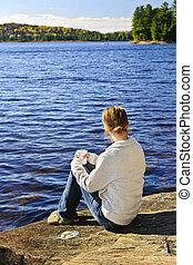 Woman relaxing at beautiful lake