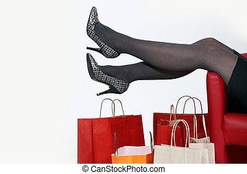 Woman relaxing at home after shopping trip