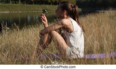 woman relaxing by the river