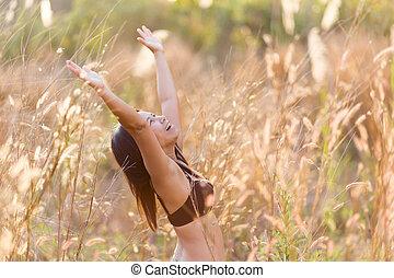 Woman relaxing in a field