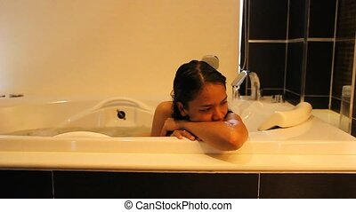 woman relaxing in a Jacuzzi.