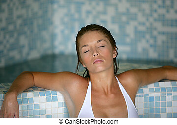 woman relaxing in a spa center