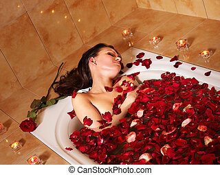Woman relaxing in bath. - Woman relaxing in bath with rose ...