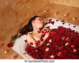 Woman relaxing in bath. - Woman relaxing in bath with rose ...