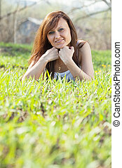 woman relaxing in grass