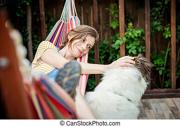 woman relaxing in hammock summer at home