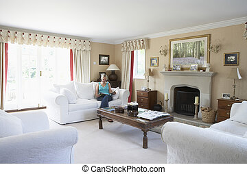 Woman Relaxing In Lounge