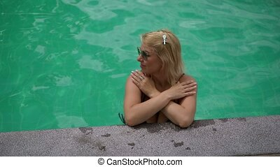 Woman relaxing in pool