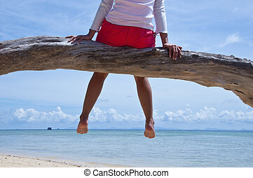 woman relaxing in the beach