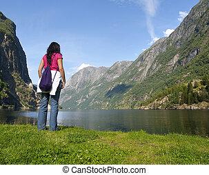 Woman relaxing in the fjord of Gudvangen