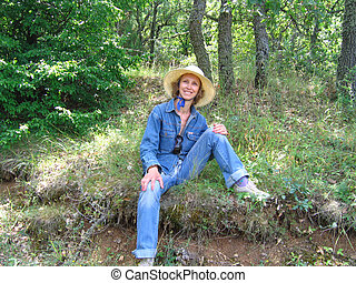 Woman relaxing in the forest