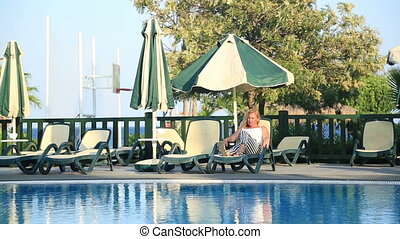 Woman relaxing near the pool