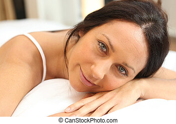 Woman relaxing on a bed