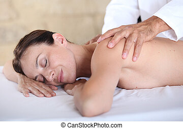 Woman relaxing on a massage bed