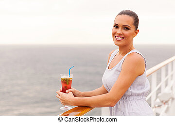 woman relaxing on cruise ship deck with cocktail