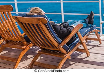 Woman Relaxing on Deckchair - Caucasian Woman Relaxing on a...