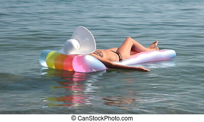 woman relaxing on raft