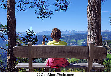 woman relaxing on the alps