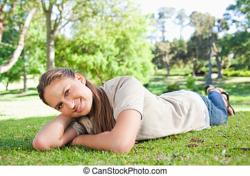 Woman relaxing on the grass