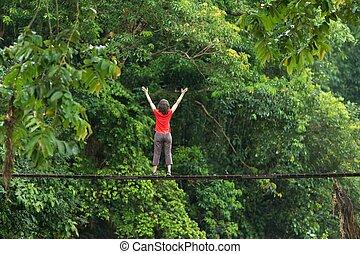 Woman relaxing on wooden bridge