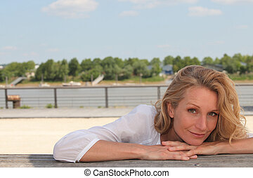 woman relaxing outdoors