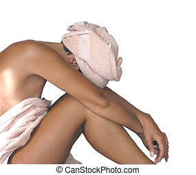 woman relaxing - woman in towels, relaxing at the spa