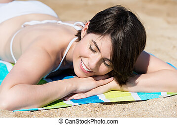 Woman relaxing sunbathing on the beach