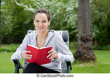 Woman relaxing with a book