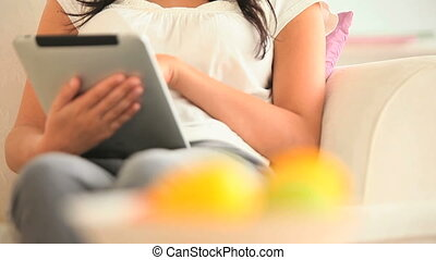 Woman relaxing with a tablet comput