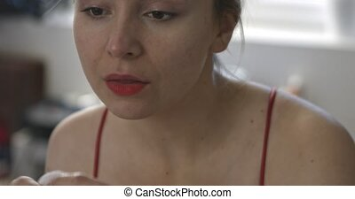 Woman remove lipstick from mouth - Woman wiping her mouth...