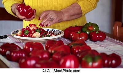 Woman Removing Core To Peppers - Footage of woman removing...
