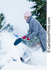 Woman Removing Snow from a Car with a Broom