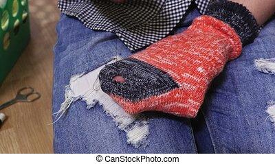 Woman repair sock