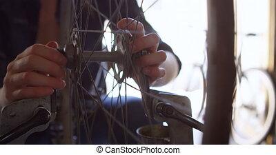 Woman repairing and checking bicycle 4k - Woman repairing...